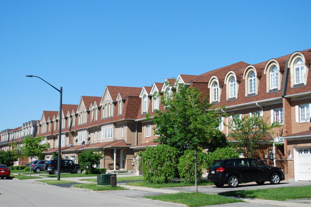 A shot of freehold town houses in Churchill Meadwos