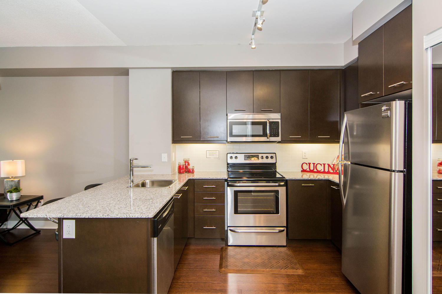 Leased 360 square one dr lime light condominiums the for Modern condo kitchens
