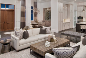Pair of identical cream sofas in a monochromatic living room