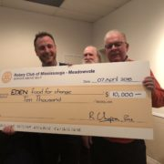 Jeffrey O'Leary poses with a cheque for $10,000 donated to the Eden Food Bank